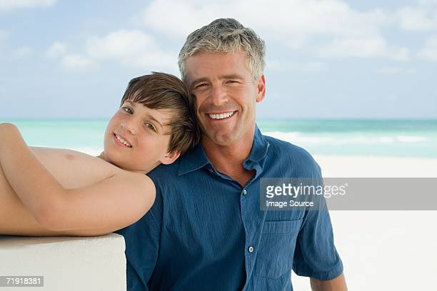 Father and son by the beach