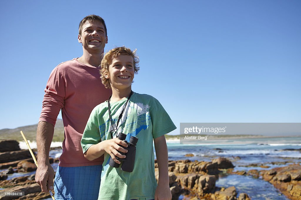 Father and son by the sea : Stock Photo