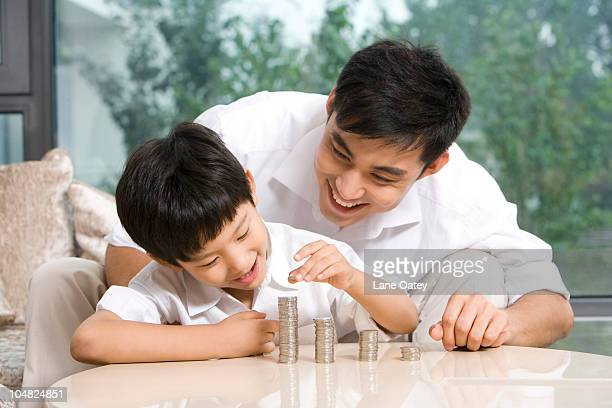 Father and son calculating coins