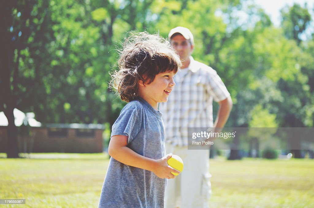 Father and son catch : Stock Photo