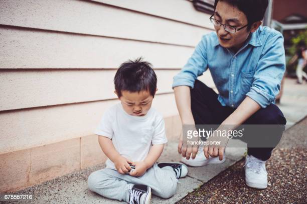 father and son chinese playing together