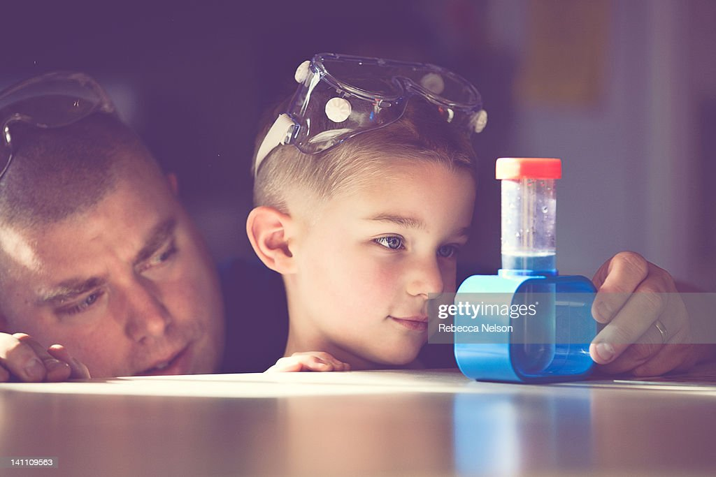 Father and son conducting science experiment : Stock Photo