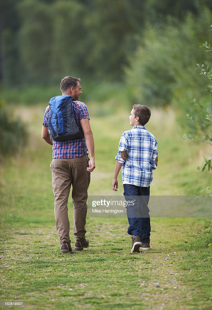 Father and son conversing during countryside walk. : Stock Photo