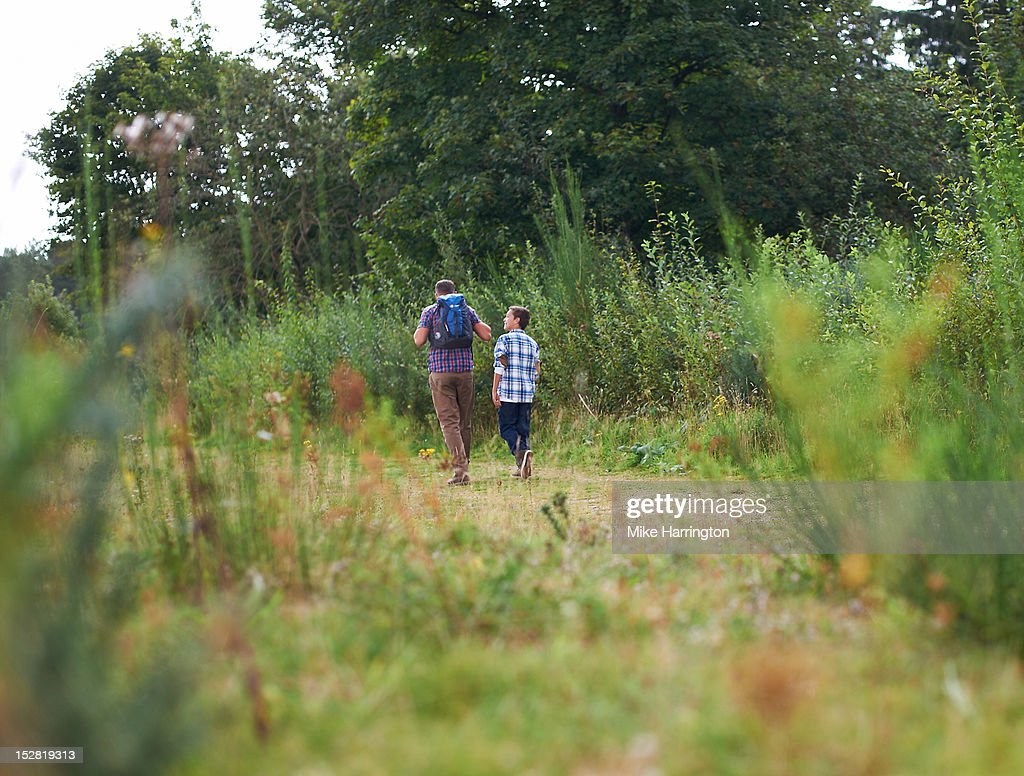 Father and son conversing during heathland walk. : Stock Photo