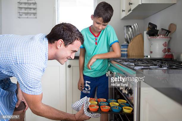 Father and son cooking together in their kitchen