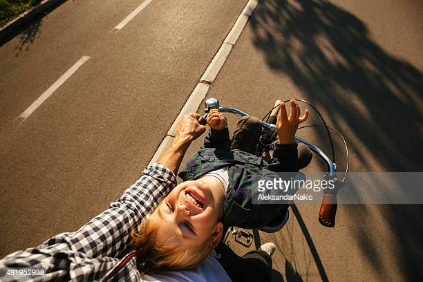 Father and son cycling together