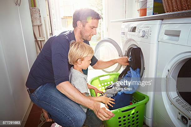 Father and son doing laundry together