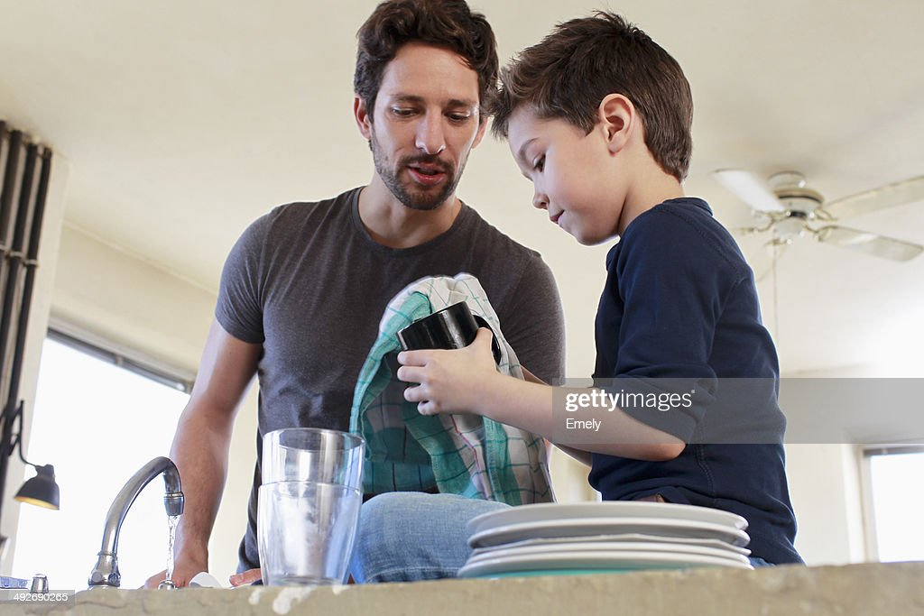 Father and son doing washing up chores : Stock Photo