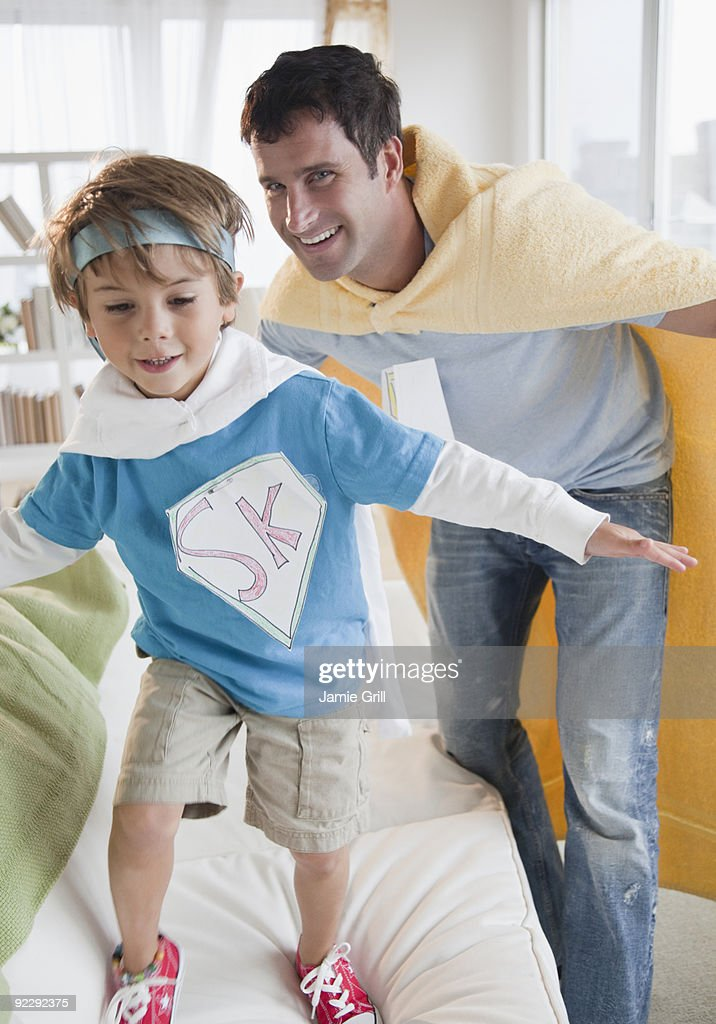 Father and son dressed up as super heroes : Stock Photo