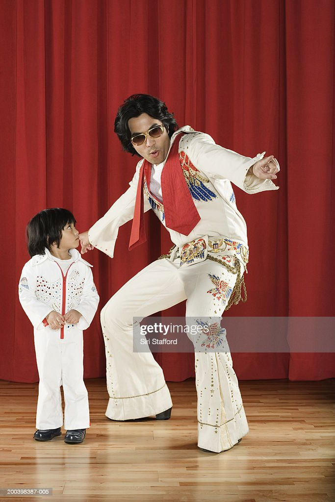 Father and son (2-4) Elvis impersonators on stage