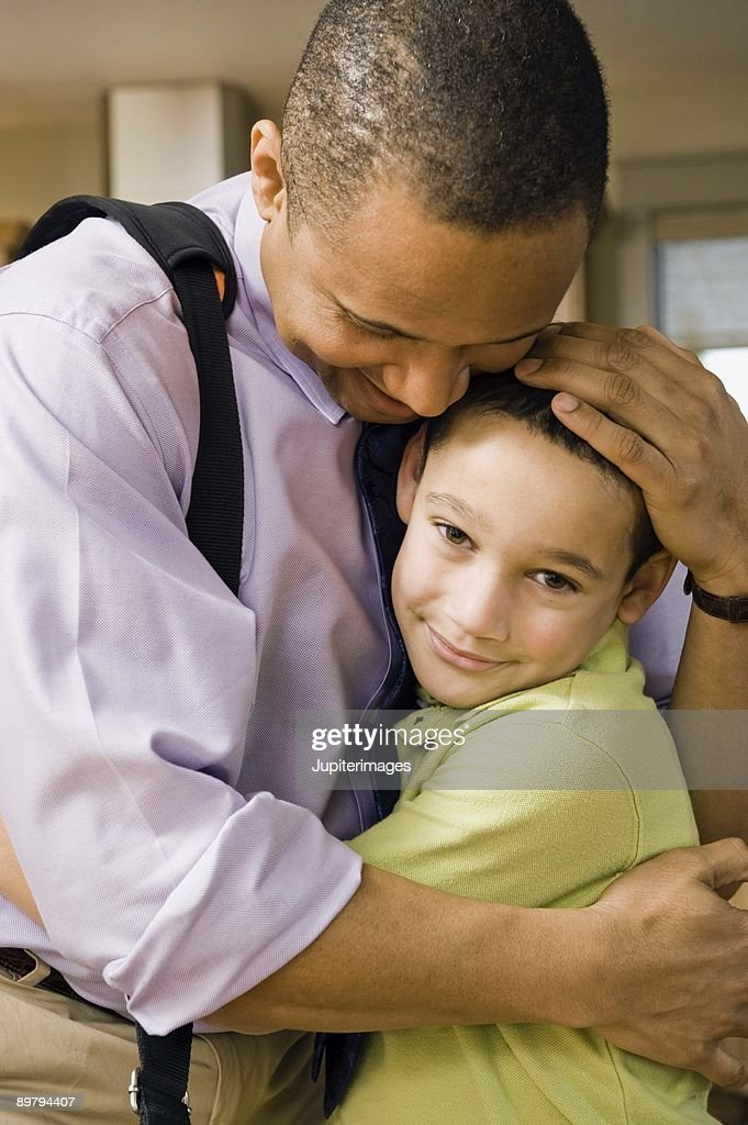 Father and son embracing : Stock Photo