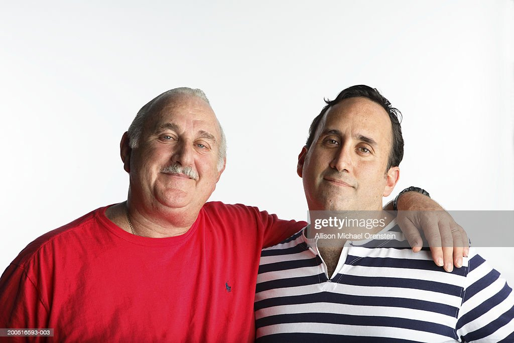 Father and son embracing, portrait : Stock Photo