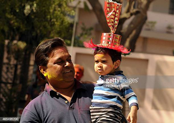 A father and son enjoy play of colours on the occasion of Holi 'The Festival of Colours' on March 6 2015 in Indore India Festival of colors fun and...