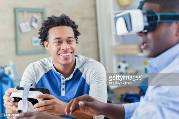 Father and son enjoy virtual reality goggles