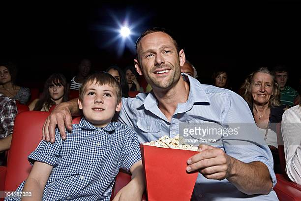 Father and son enjoying a movie