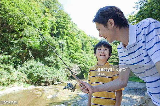 Father and Son Enjoying Fishing
