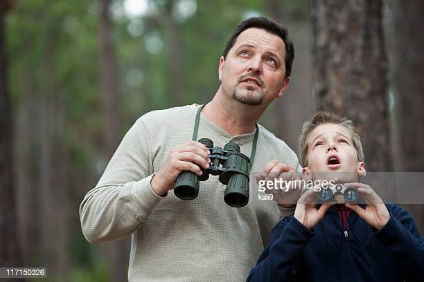 Father and son enjoying scenic view with binoculars