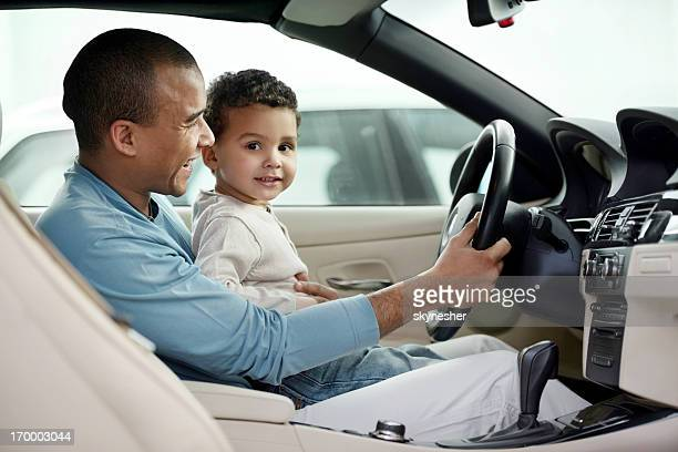 Father and son enjoying the ride.