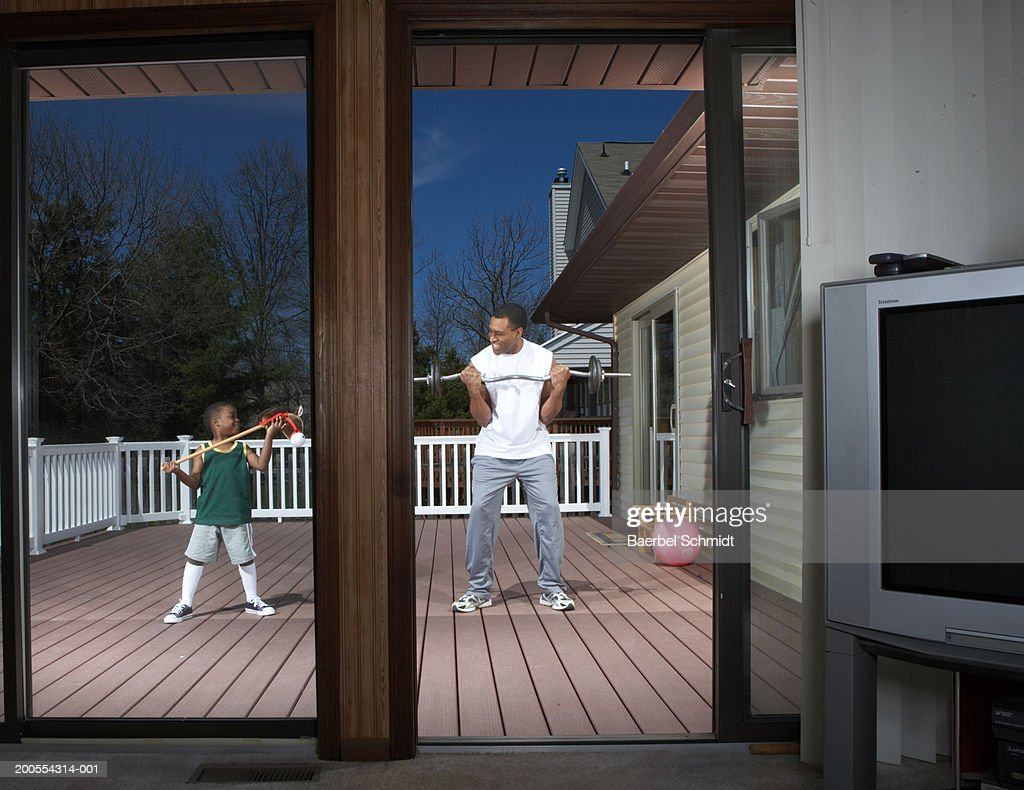 Father and son (4-5) exercising : Stock Photo
