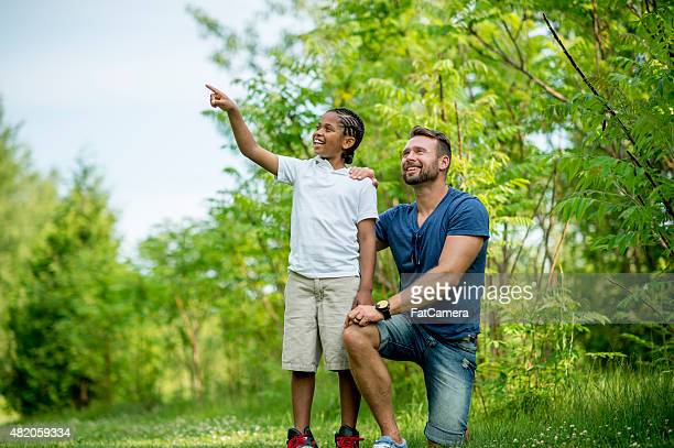 Father and Son Exploring Nature