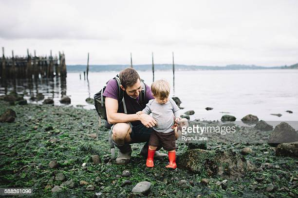 Father and Son Exploring Rocky Beach