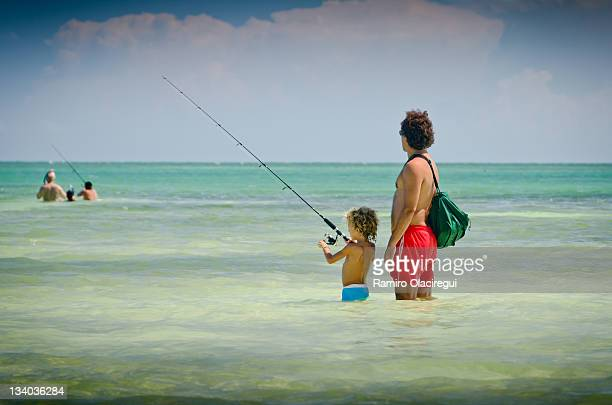 Father and son fishing on ocean, Caribe water