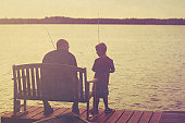 Father and son fishing onpier