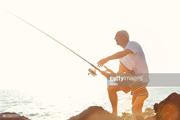 Father and Son Fishing Together.