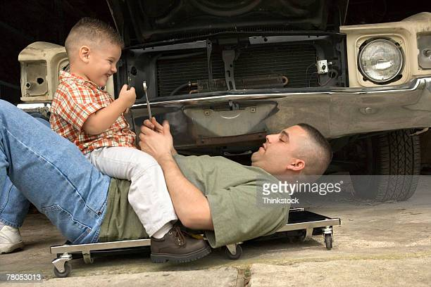 Father and son fixing car