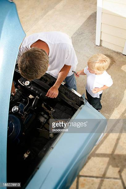 Father and Son Fixing the Car