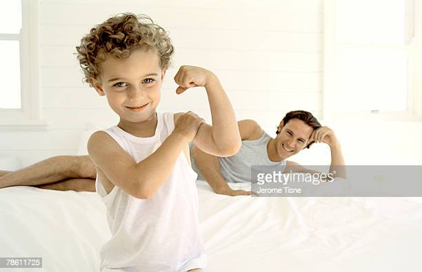 Father and son flexing muscle