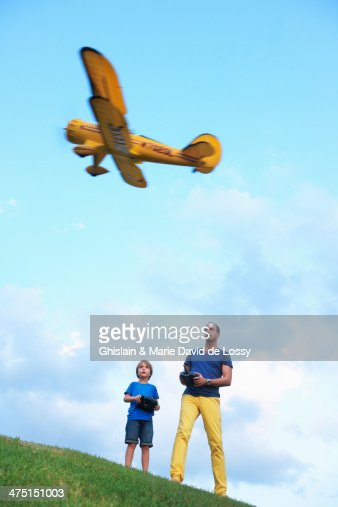 Father and son flying model plane