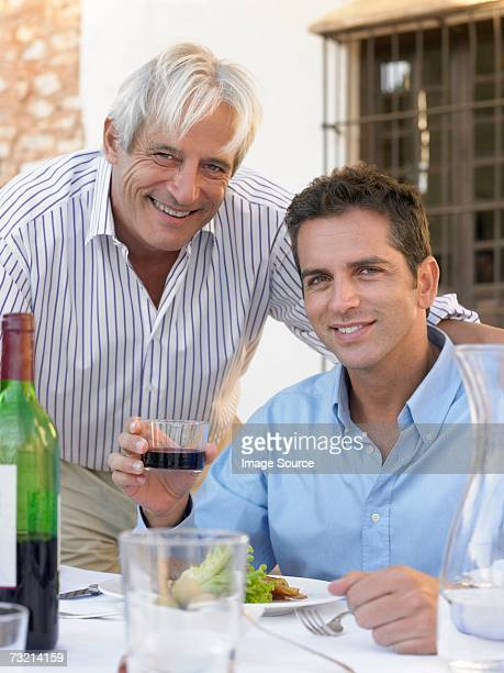 Father and son having a meal