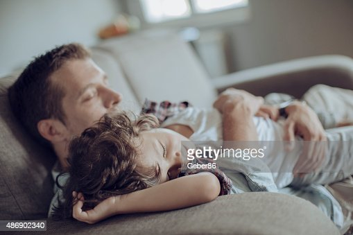 Father and son having nap : Stock Photo