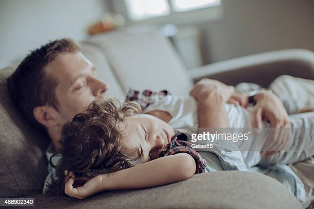 Father and son having nap