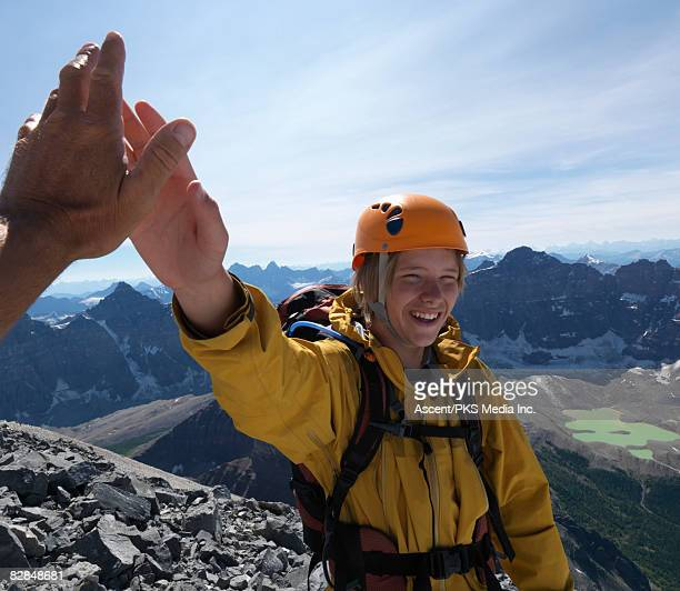 Father and son 'high-five' on mountain summit