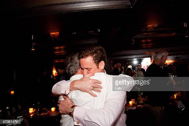 Father and son hugging at party