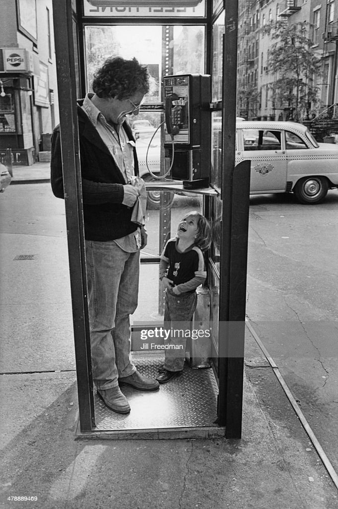 A father and son in a phonebooth in Greenwich Village, New York City, 1976.