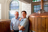 Father and son in brewery