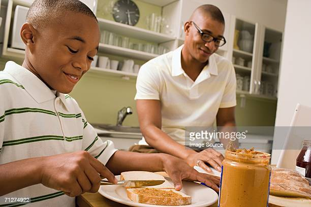 Father and son in eating in kitchen