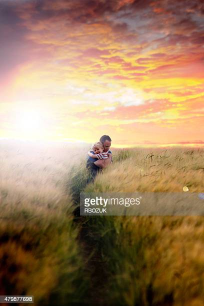 Father and Son in Field at Sunset