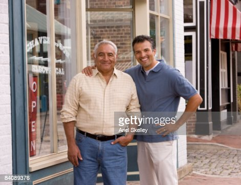 Father and Son in Front of Family Business : Stock Photo