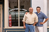 Father and Son in Front of Family Business
