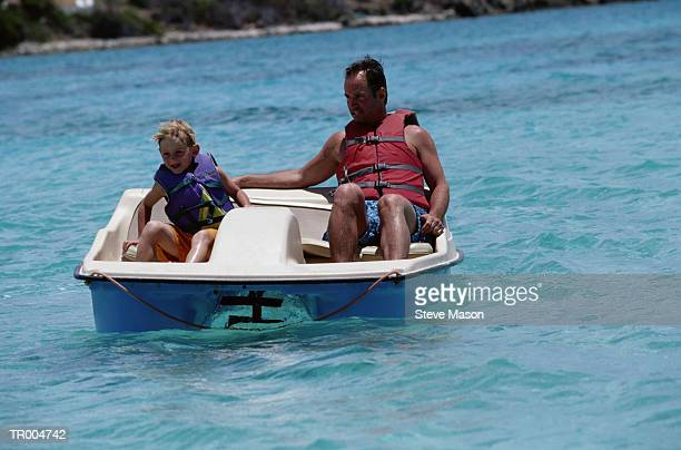 Father and Son in Paddle Boat