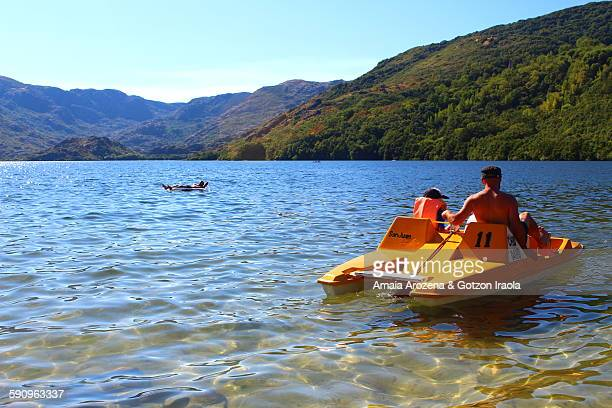 Father and son in paddle boat, Sanabria Lake