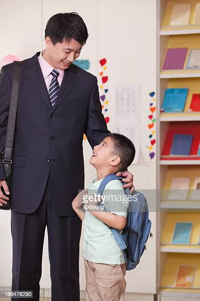 Father And Son In School Classroom