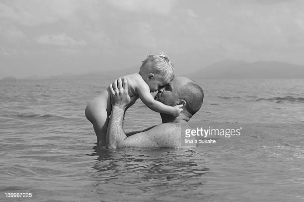 Father and son in sea water
