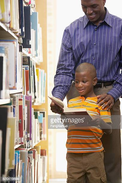 Father and son in the library