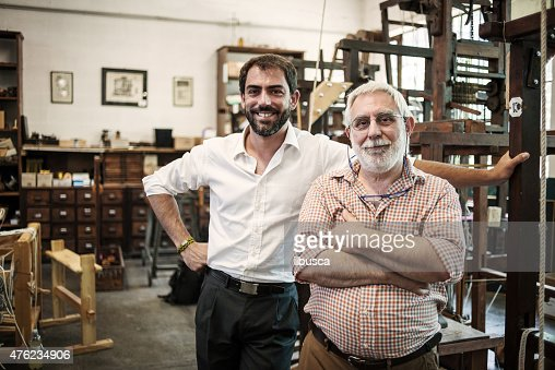 Father and son in their artisanal handicraft traditional textile factory