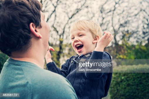Father and son laughing together : Stock Photo